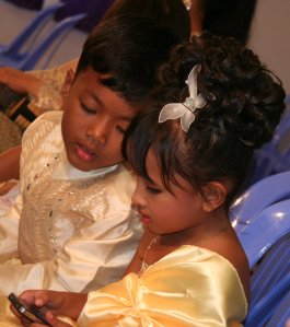 Youngest members of the bridal party amusing themselves
